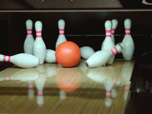 bowling ball and bowling bins in a bowling alley